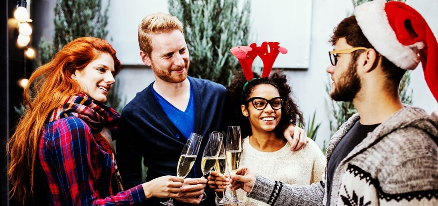 4 young people give a toast on Christmas Eve over the tag line Swiss Sauce
